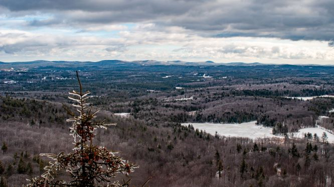 A landscape of mountaintops as seen from Mount Monadnock's Little Mountain Viewpoint.
