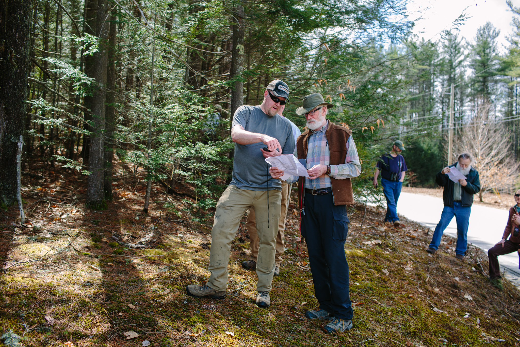 Outdoor conservation volunteers navigate property boundaries