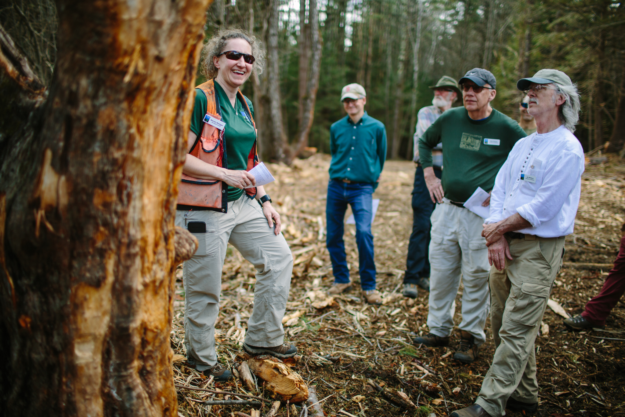 Volunteer land stewards learn about forest ecology from managing forester Wendy Weisiger