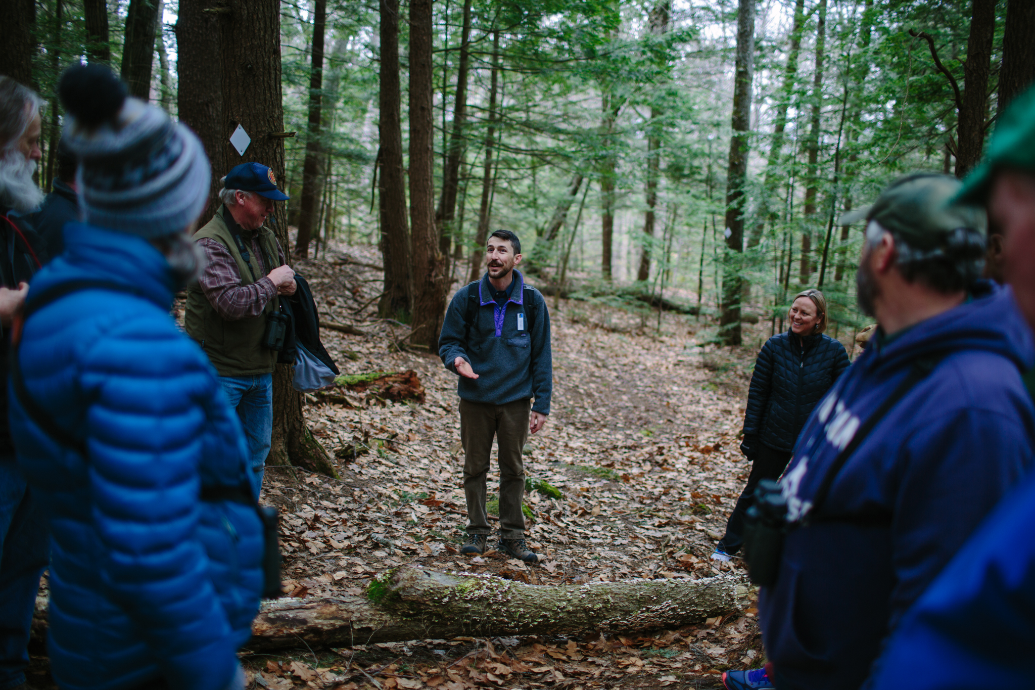 Program Coordinator Andy Crowley gives advice on clearing debris from a hiking trail
