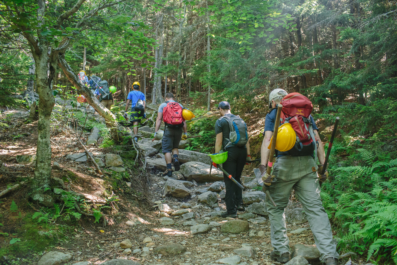 Volunteers hike in tools for trail restoration projects on Mount Monadnock