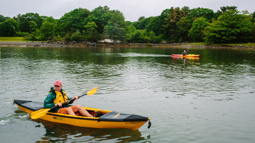 Volunteers collect trash as part of a kayak clean up in the Seacoast