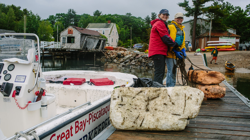 Melissa Paly and volunteer with the Great Bay — Piscataqua Waterkeeper boat