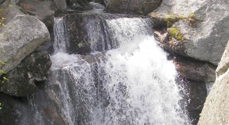 Water falls through granite rocks.