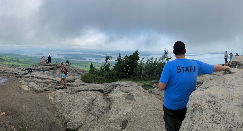 Soaking in the summit views at Mount Major in Alton New Hampshire