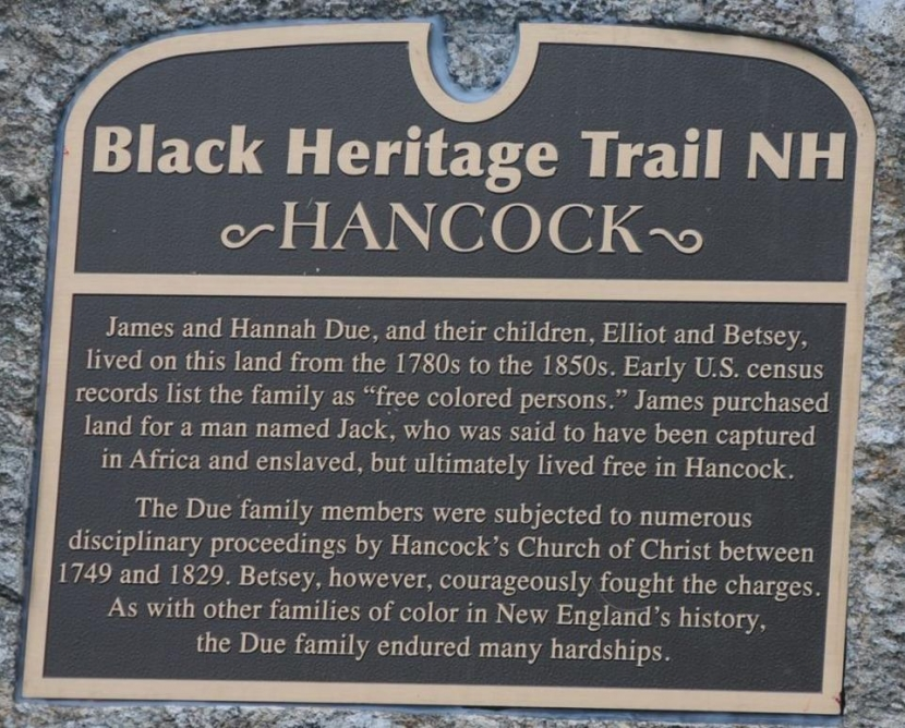 The marker unveiled on a stone at the property is black and gold.