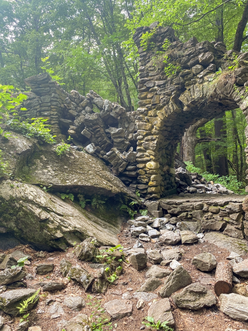 Stones are scattered below where the top arch of the staircase used to stand, with the two remaining arches below.