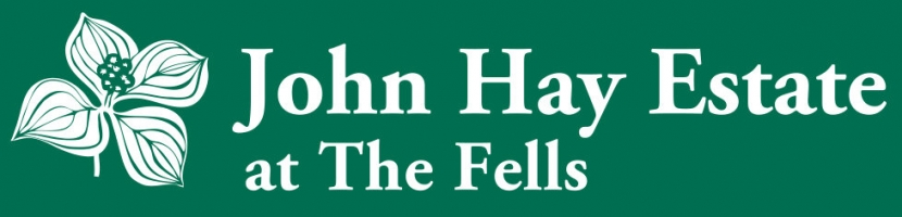 The green and white logo of The Fells.