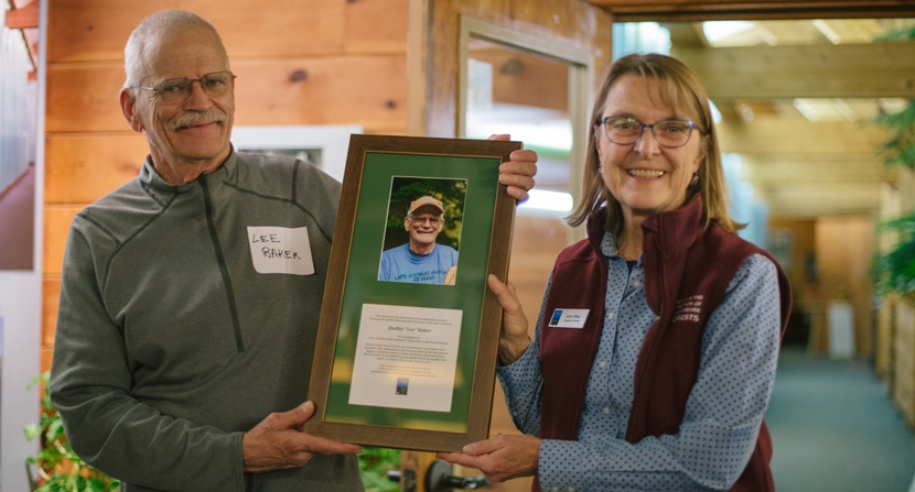 Lee Baker is awarded Volunteer of the Year by Forest Society president/forester Jane Difley