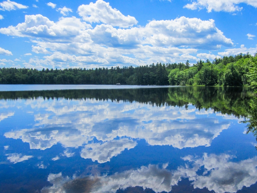 A reflection of blue skies and clear water at Lake Massabesic.