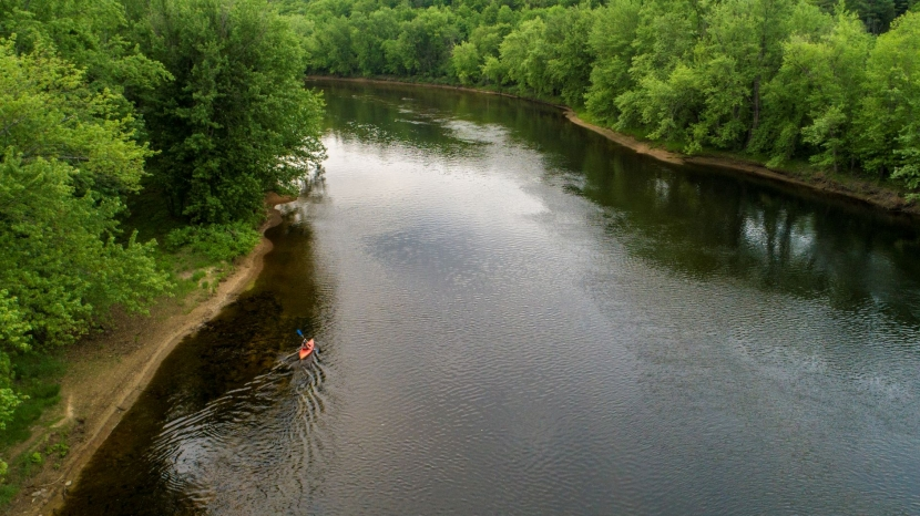 A birds-eye view of the Merrimack River meandering next to Stillhouse Forest.