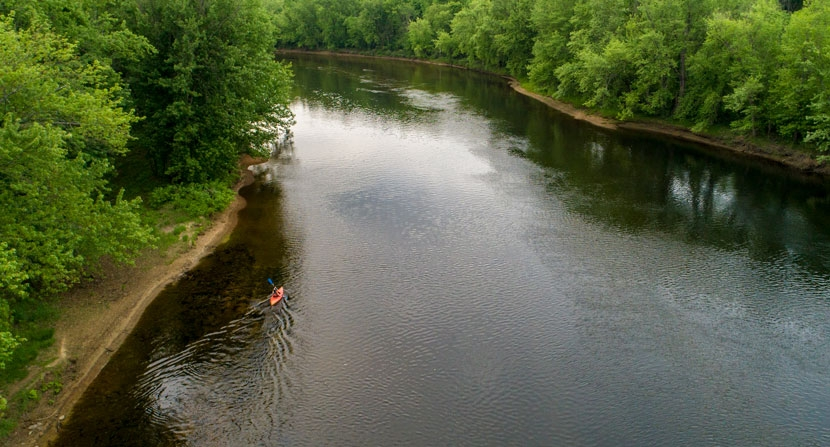 A kayaker paddles on the Merrimack River in Canterbury, New Hampshire