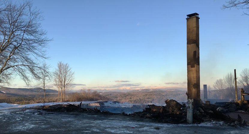 Only the chimney is left standing after a fire at the Rocks in Bethlehem New Hampshire