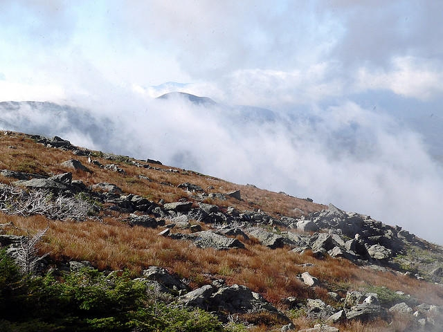 A southwesterly view of Mount Washington with clouds above.