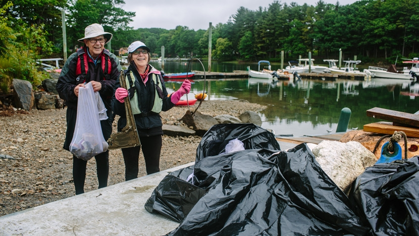 Volunteers collect trash in the estuary in Portsmouth
