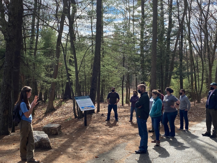 field trip participants masked and distanced stand along Lovewell Pond