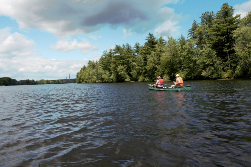 Two people in a canoe on the Merrimack River.