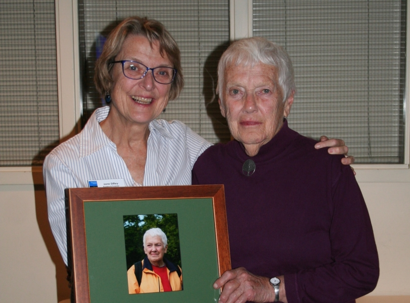 Jane Difley and Martha Chandler pose together with a plaque between them.