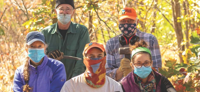 Masked members of the Forest Society's conservation corps gather.