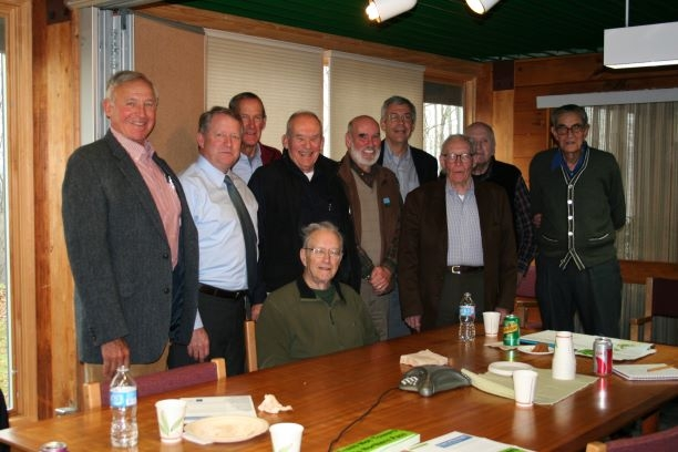 Members of the President's Foresters Council gather for a photo in the conference room at the Forest Society.