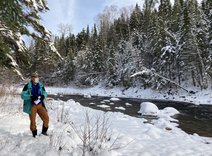 Tom Howe looks over the snowy Ammonoosuc River during a site visit.