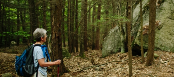 Hiker takes in the view of large boulders on the trail