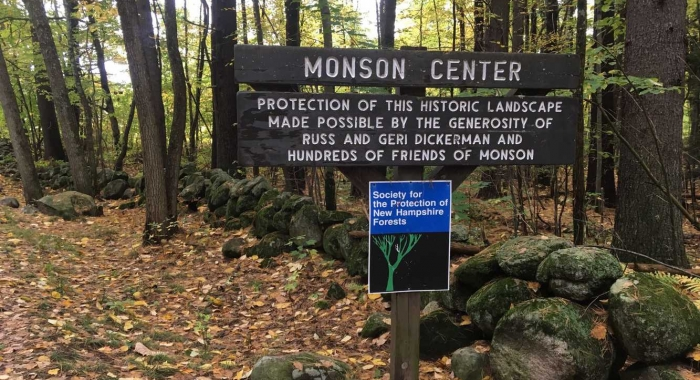 A wood sign at the entrance to Monson Center.