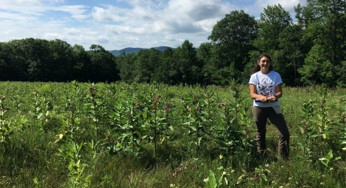 Researcher Katie Galletta standing in High Five fields.