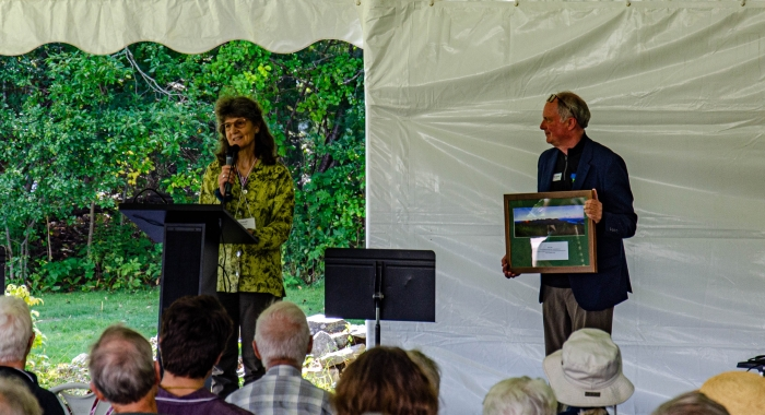 Sarah Thorne, wife of the late Tom Howe, accepted the award from President Jack Savage on stage at the annual meeting.