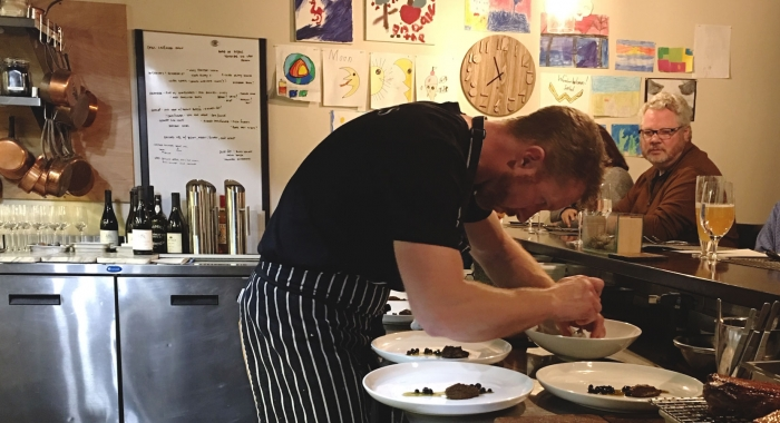 Chef Evan Hennessey plates at the Chef's Counter at his restaurant, Stages at One Washington Street in Dover.