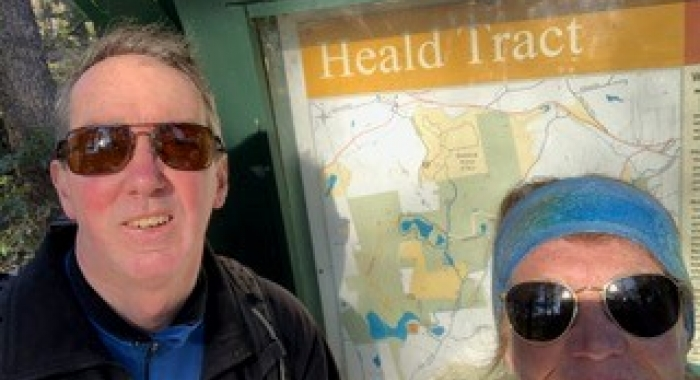 David and Lynne Bishop pose in front of the kiosk at Heald Tract.