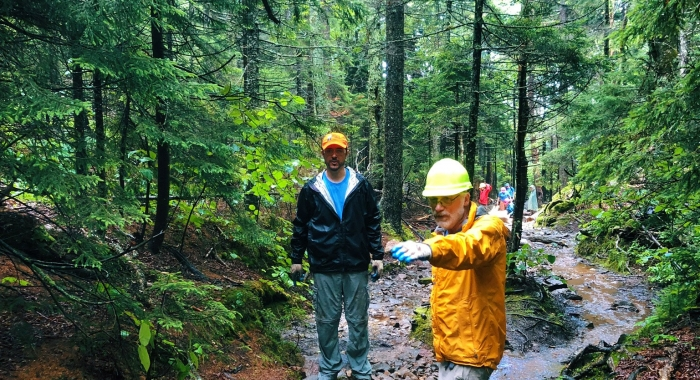 Forest Society Forester Steve Junkin and Volunteer Dave Heuss strategize where to move rocks in order to divert water around a section of the White Arrow Trail at Mount Monadnock.