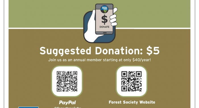 A sign with a QR code suggests a $5 donation to support trail stewardship.