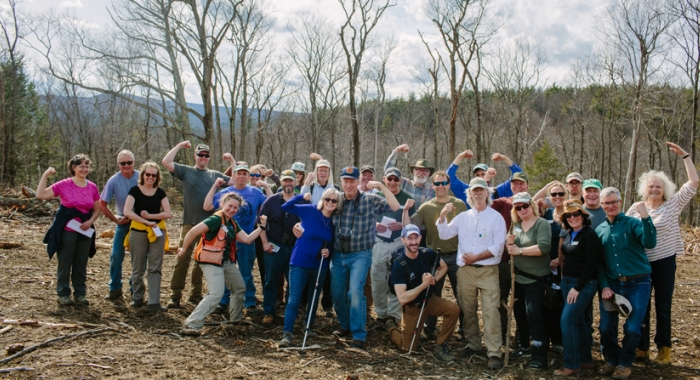 Land Steward volunteers flex their muscles during a walk on the Heald Tract in Wilton