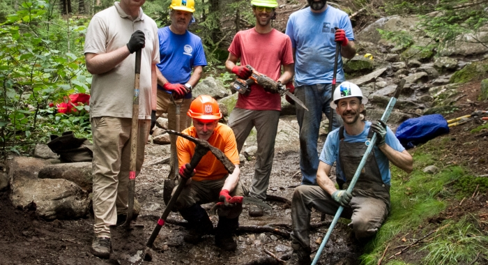 A work crew on Mount Monadnock improves the trail.