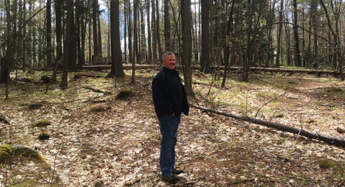 Mike Morison standing in his woods