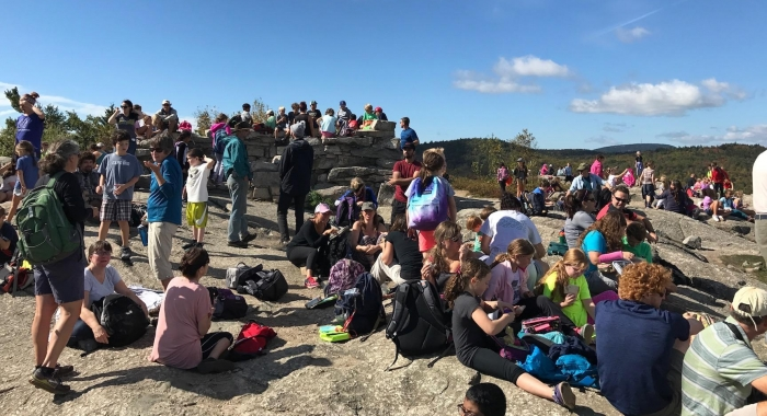 Mount Major summit covered with people during a school hike