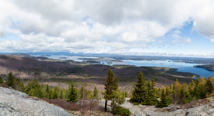 A panorama of Lake Winnipesaukee in the summer as seen from the top of Mount Major.