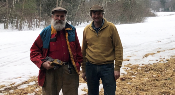 Dorn and Chuck Cox pose in front a snow covered field at Tuckaway Farm.