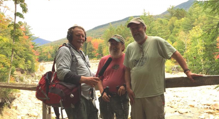 Dave Anderson, Mike Dickerman and Steve Smith pose on a bridge above the Pemigewassett Wilderness Trail at the Lincoln Woods Trailhead.