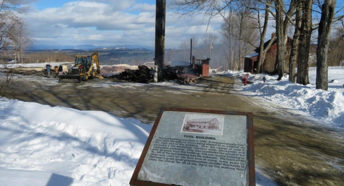The 115-year-old Tool Building at The Rocks, depicted in this sign at the Bethlehem property owned by the Forest Society, was reduced to rubble, apart from its tall chimney by a fast-moving fire on Feb. 13.