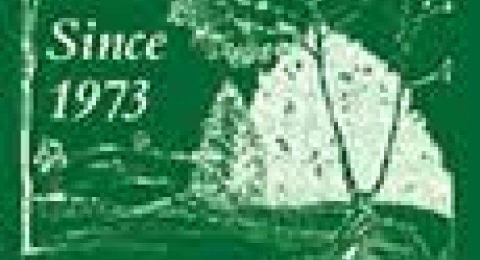 Current use logo green in white block print with trees wording since 1973