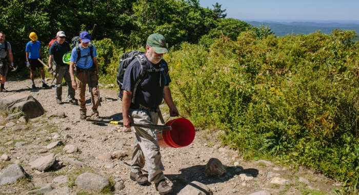 Volunteers hike tools and gear up Mount Monadnock for trail stewardship projects with the Forest Society and NH State Parks