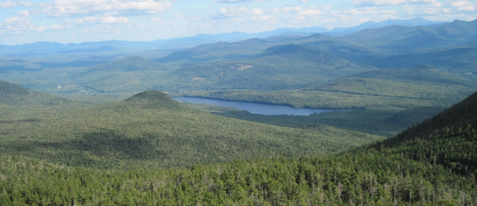 A vast forest and mountain ridges surrounded Christine Lake.
