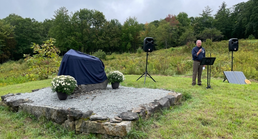 Forest Society President Jack Savage speaks in front of the marker at the event.