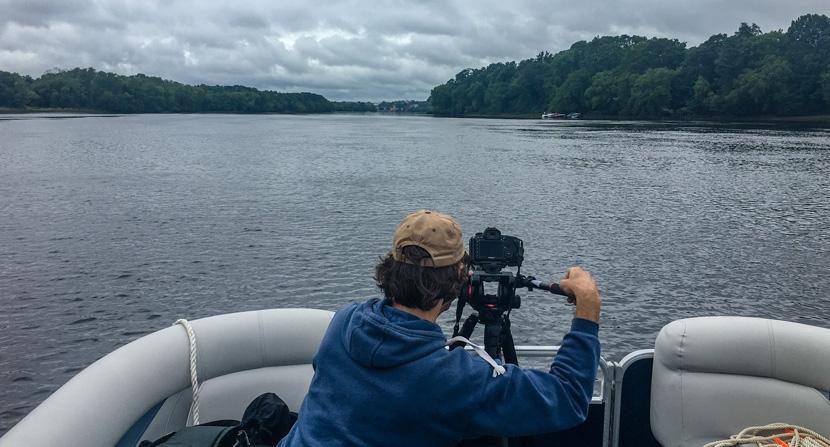 Videographer filming lower Merrimack between Newburyport and Haverhill, Mass