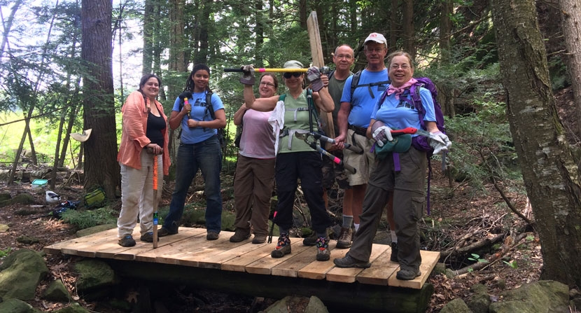 Volunteer show off a newly completed hiking bridge at Monadnock Trails Week