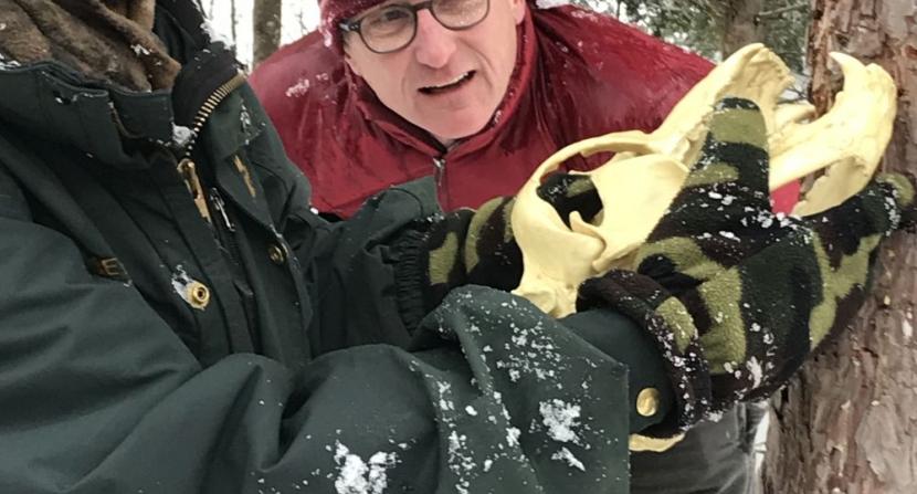 Nick Scheu looks at Sue Morse with Yorick, the bear skull. Photo DA