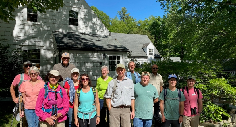 Hikers pose before hike at The Fells Gate House Visitor Center