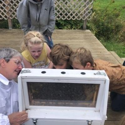 Janice Mercieri of White Mountain Apiary shows kids beekeeping equipment.